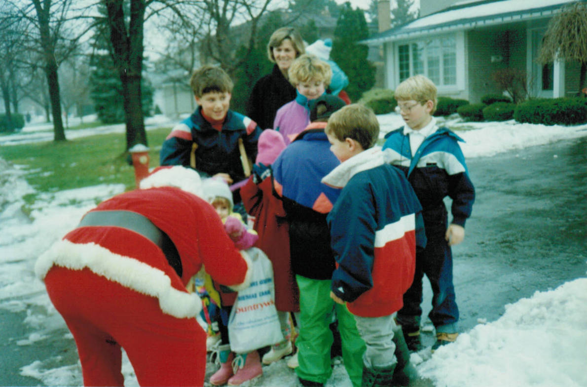 Santa Clause give candy to Markland Wood children during MWHA Christmas Caravan & Food Drive in the 1980's